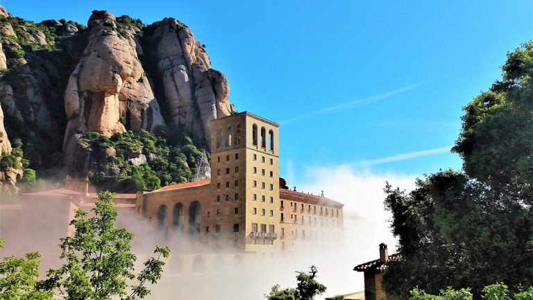 montserrat Monastery into the clouds during a day montserrat tour