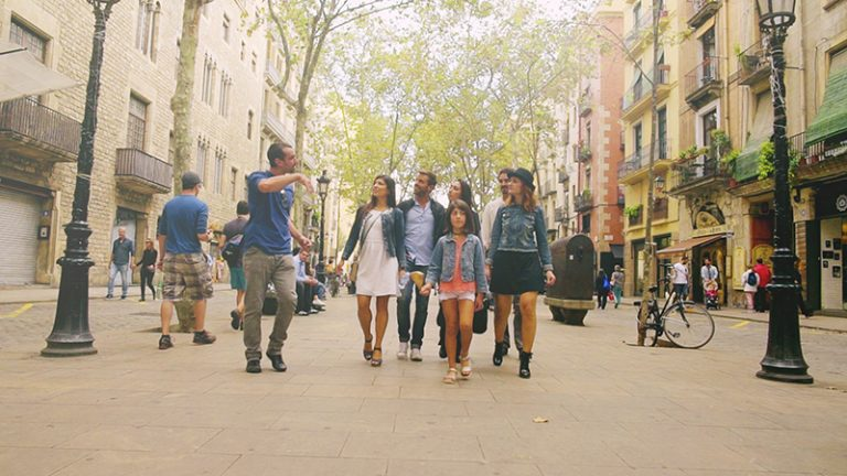 a group of people walking in the old town of barcelona during a walking tour
