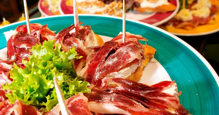 plates of tapas and pinchos with spanish ham at Barcelona restaurant