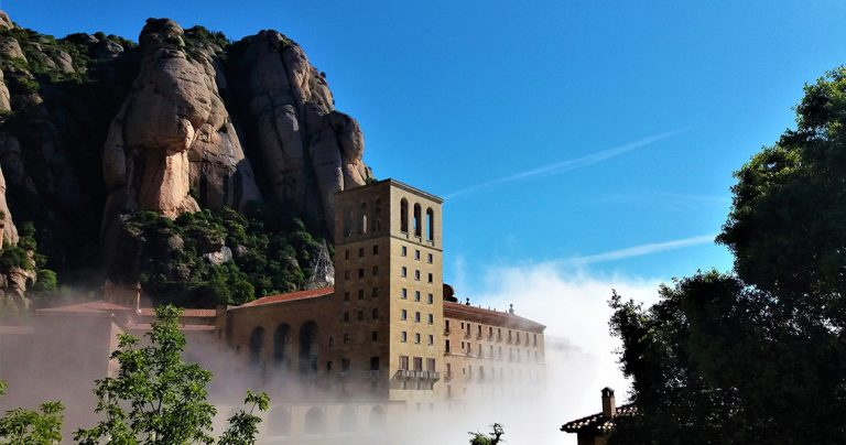 Montserrat monastery on the hills surrounded by fog