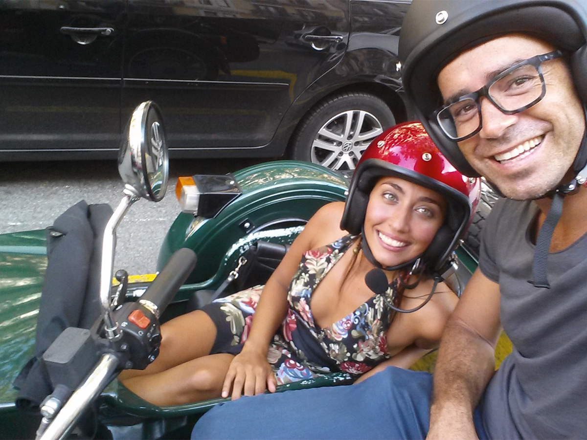 selfie of man and woman on sidecar motorcycle