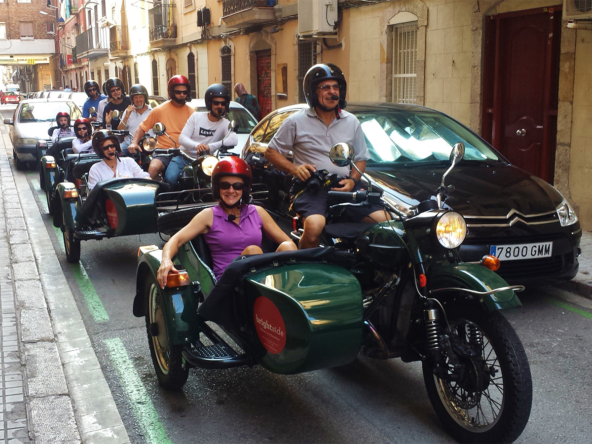 five sidecars with smiley passengers duringa a sidecar tour of Barcelona