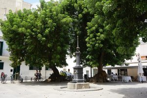 Public fountan in the middle of Prim square in Poblenou district of Barcelona