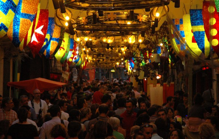 decorated street during fiesta mayor de gracia