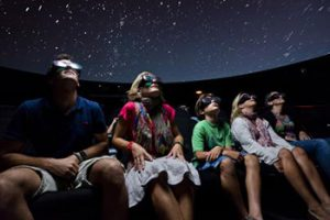 family watching 3d movie in museum