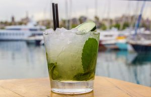 Mojito drink with port on the background.