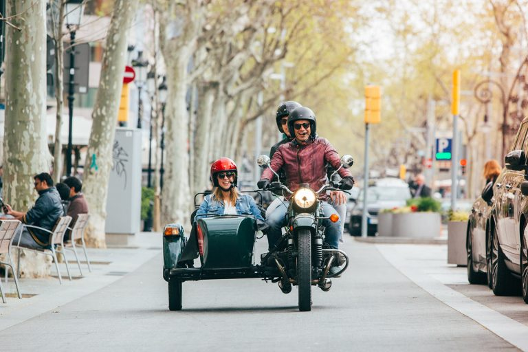 Sidecar motorcycle cruising with three passengers in Barcelona