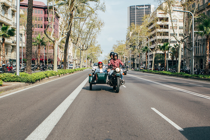 Sidecar motorcycle cruising Diagonal Avenue in Barcelona.