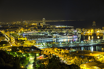 View over the old Port of Barcelona at night.