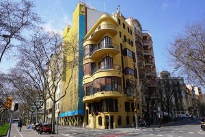 Six story high yellow building in Barcelona city.