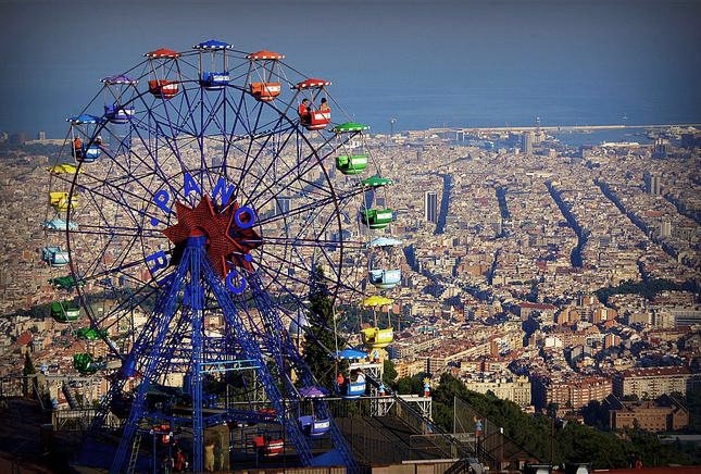 ferris wheel on tibidabo hill in barcelona and the views of the city in the background