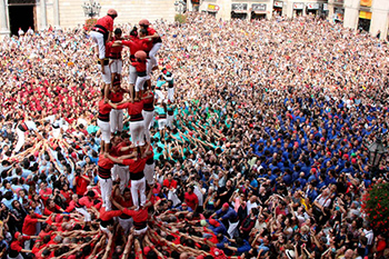 Human tower in catalan square full of people