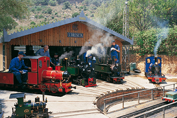 old miniature trains exiting the station in Oreneta park
