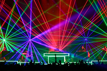 DJ performing on stage with many led lights