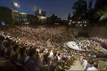 amphitheatre with crowd looking at a concert