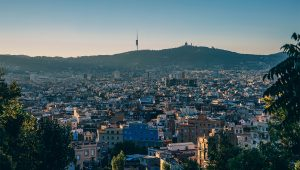 Evening view of Barcelona, Collserola national park and Tibidabo hill.