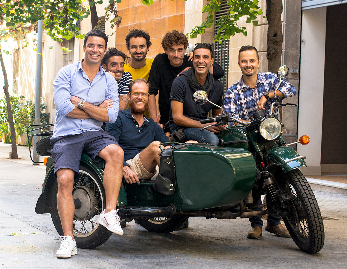 Brightside Tours group of seven local tour guides sitting on a sidecar motorcycle.