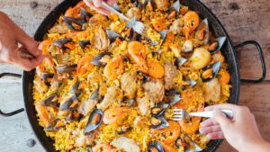 traditional style paella with seafood served in Barcelona restaurant