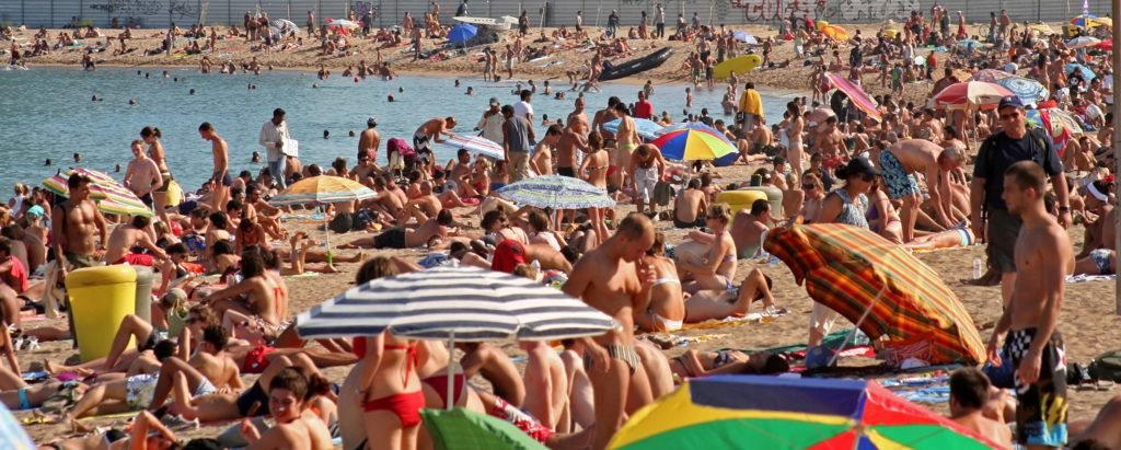 Beach in barcelona withe heavy crowds.
