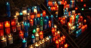Lit up candles in Monstserrat monastery near Barcelona.