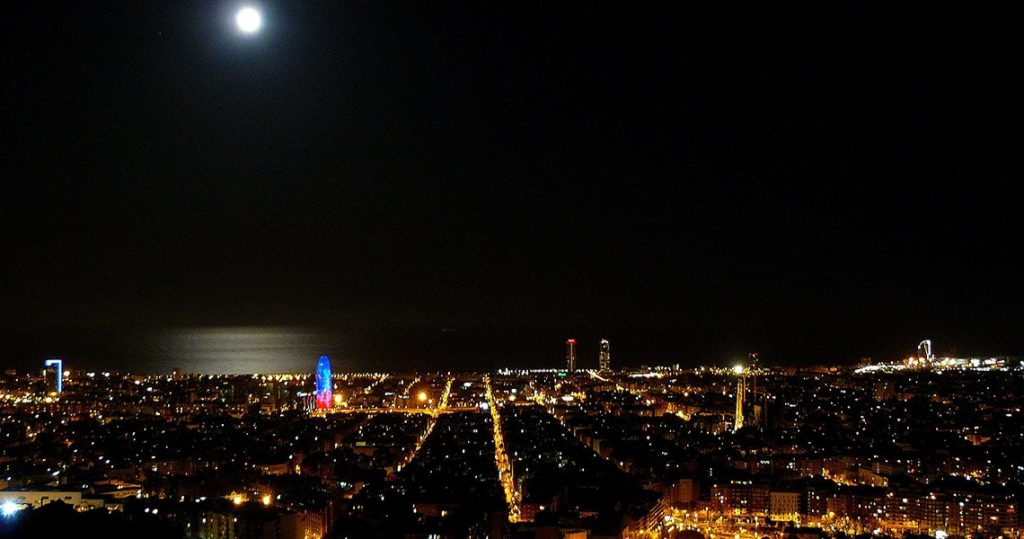 "View over Barcelona at night from hilltop viewpoint known as ""The bunker""."