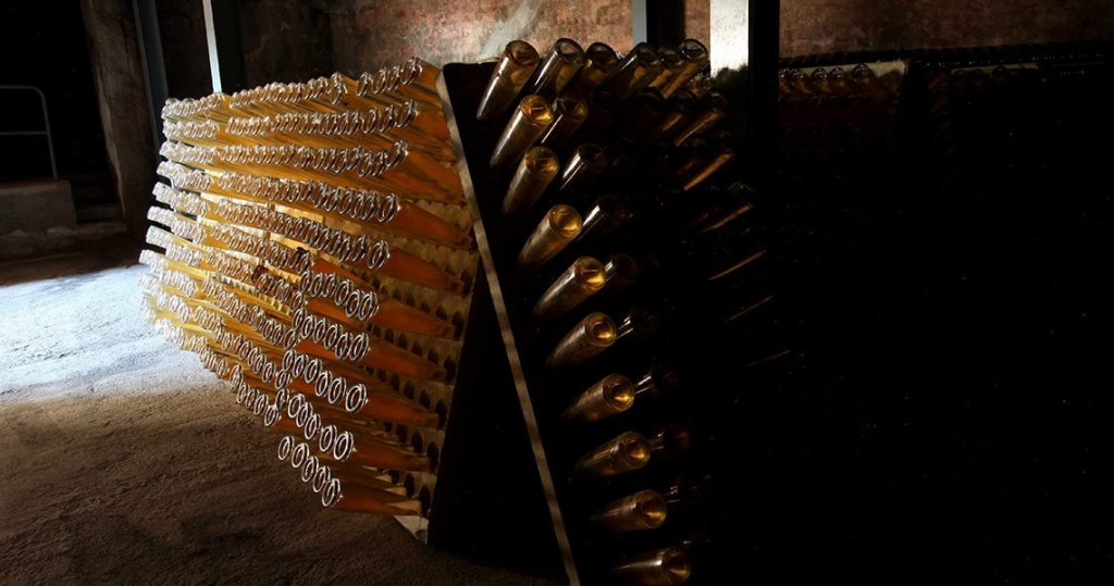 Aging of botlles of Cava sparkling white wine.
