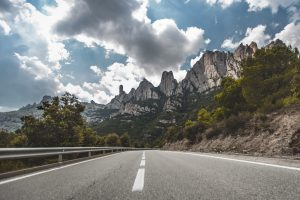 Country road leading to Montserrat mountain near Barcelona