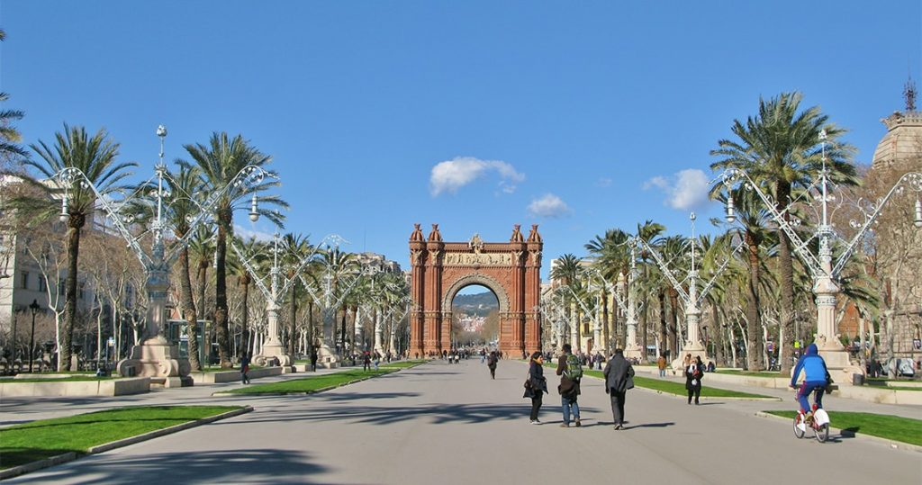 Arc de Triomf of barcelona with people on bicycles