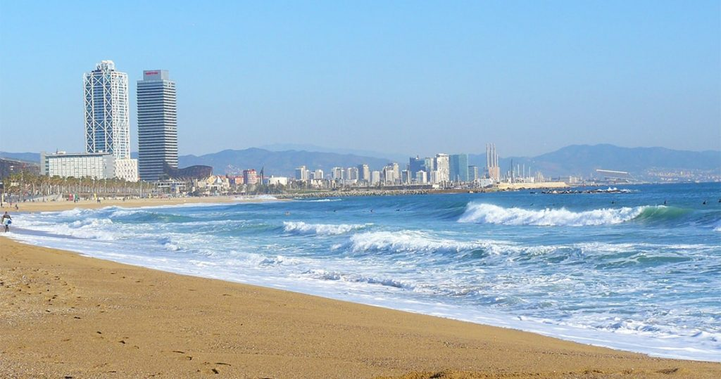 Coastline of barcelona with buildings on the background