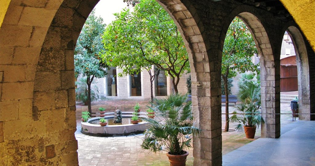 Gothic courtyard garden in Barcelona old town.