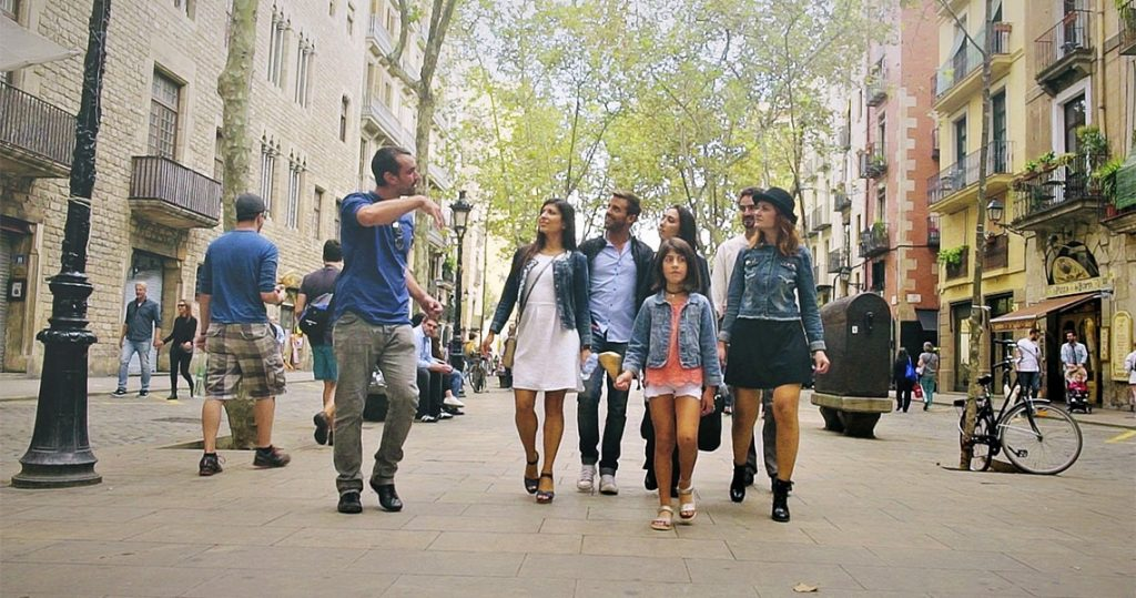 group of people walking tour in barcelona old town
